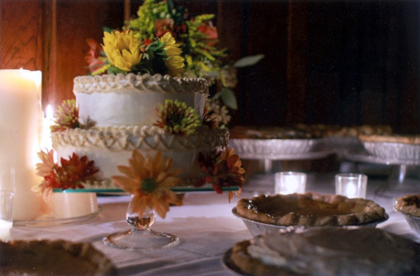 Bride Cutting Pie made by Main Street Bakery & Catering Luray VA